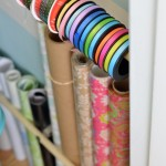 Use-dowel-rods-and-curtain-rod-brackets-for-wrapping-supplies
